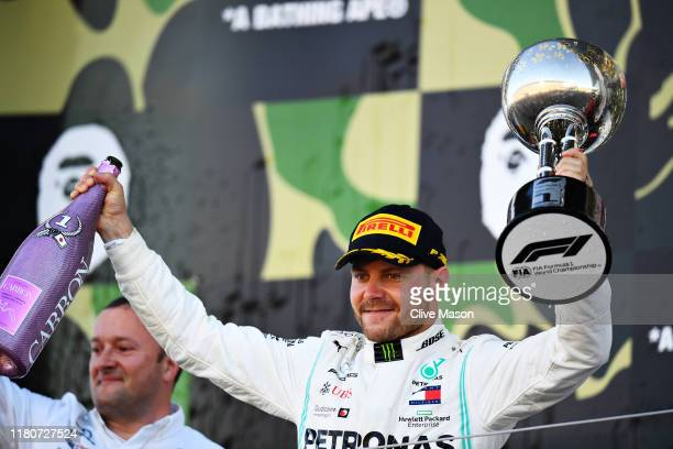 Race winner Valtteri Bottas of Finland and Mercedes GP celebrates on the podium during the F1 Grand Prix of Japan at Suzuka Circuit on October 13...