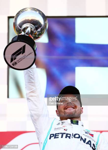 Race winner Valtteri Bottas of Finland and Mercedes GP celebrates on the podium during the F1 Grand Prix of Japan at Suzuka Circuit on October 13,...