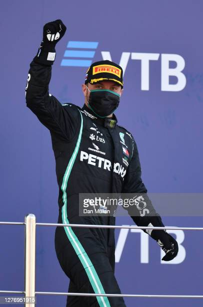 Race winner Valtteri Bottas of Finland and Mercedes GP celebrates on the podium during the F1 Grand Prix of Russia at Sochi Autodrom on September 27,...