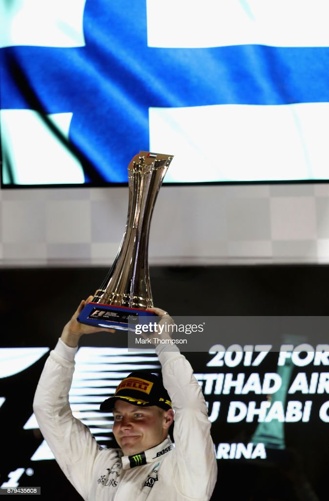 Race winner Valtteri Bottas of Finland and Mercedes GP celebrates on the podium during the Abu Dhabi Formula One Grand Prix at Yas Marina Circuit on November 26, 2017 in Abu Dhabi, United Arab Emirates.