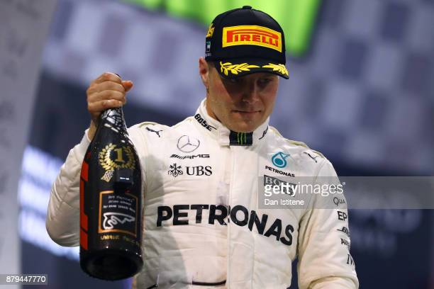 Race winner Valtteri Bottas of Finland and Mercedes GP celebrates on the podium during the Abu Dhabi Formula One Grand Prix at Yas Marina Circuit on...