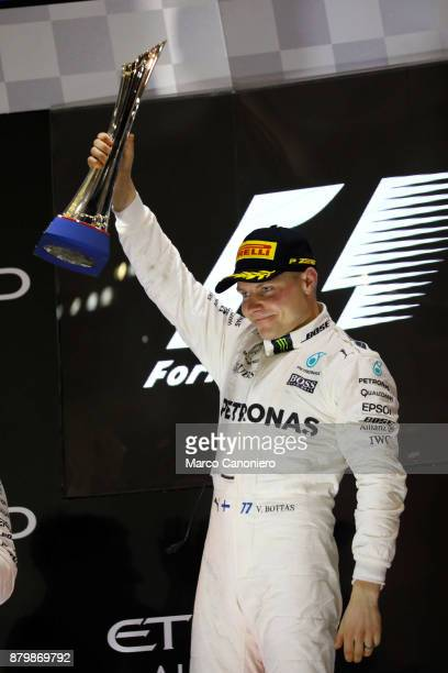 Race winner Valtteri Bottas of Finland and Mercedes GP celebrates on the podium during the Abu Dhabi Formula One Grand Prix a