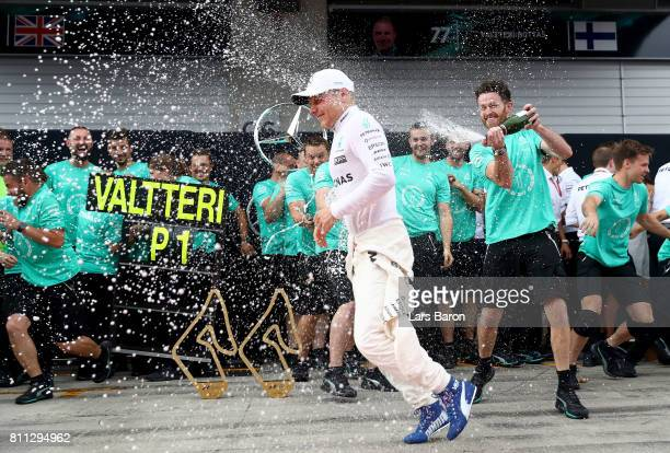 Race winner Valtteri Bottas of Finland and Mercedes GP celebrates with his team during the Formula One Grand Prix of Austria at Red Bull Ring on July...