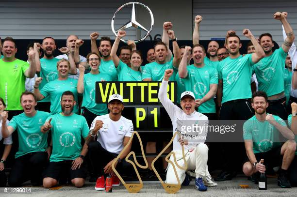 Race winner Valtteri Bottas of Finland and Mercedes GP celebrates with Lewis Hamilton of Great Britain and Mercedes GP and his team during the...