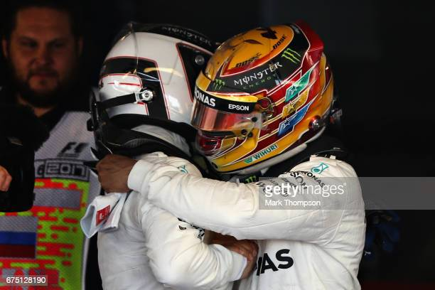 Race winner Valtteri Bottas of Finland and Mercedes GP is congratulated by team mate Lewis Hamilton of Great Britain and Mercedes GP in parc ferme...