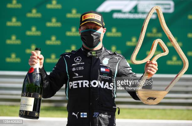 Race winner Valtteri Bottas of Finland and Mercedes GP poses with the trophy during the Formula One Grand Prix of Austria at Red Bull Ring on July...