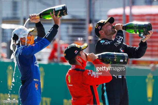 Race winner Valtteri Bottas of Finland and Mercedes GP, second placed Charles Leclerc of Monaco and Ferrari and third placed Lando Norris of Great...