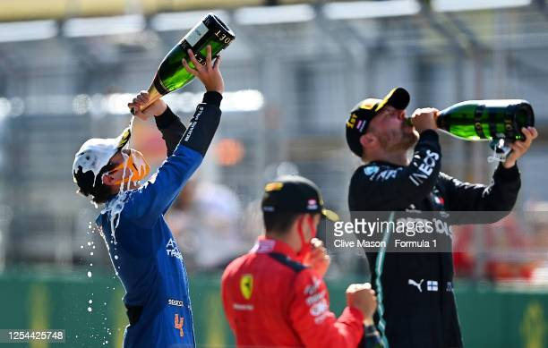 Race winner Valtteri Bottas of Finland and Mercedes GP second placed Charles Leclerc of Monaco and Ferrari and third placed Lando Norris of Great...