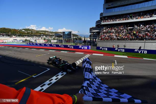 Race winner Valtteri Bottas of Finland and Mercedes GP takes the chequered flag during the F1 Grand Prix of Russia at Sochi Autodrom on September 27,...