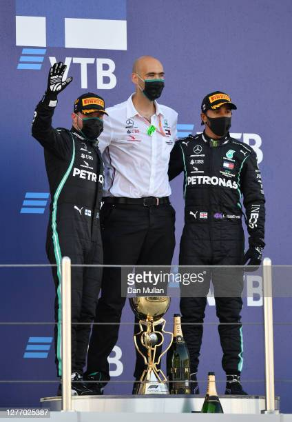 Race winner Valtteri Bottas of Finland and Mercedes GP third placed Lewis Hamilton of Great Britain and Mercedes GP and Mercedes GP race engineer...