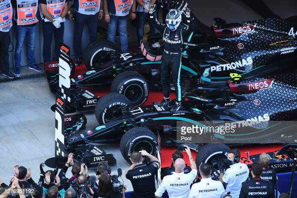 Race winner Valtteri Bottas of Finland driving the Mercedes AMG Petronas F1 Team Mercedes W11 celebrates in parc ferme during the F1 Grand Prix of...