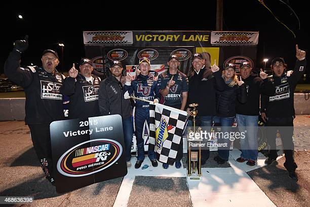 Race winner William Byron driver of the Liberty University Chevrolet celebrates after the NASCAR KN Pro Series East Kevin Whitaker Chevrolet 150 at...