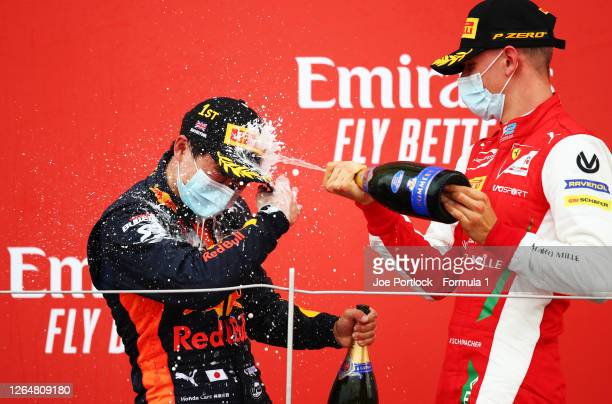 Race winner Yuki Tsunoda of Japan and Carlin and second placed Mick Schumacher of Germany and Prema Racing celebrate on the podium during the sprint...