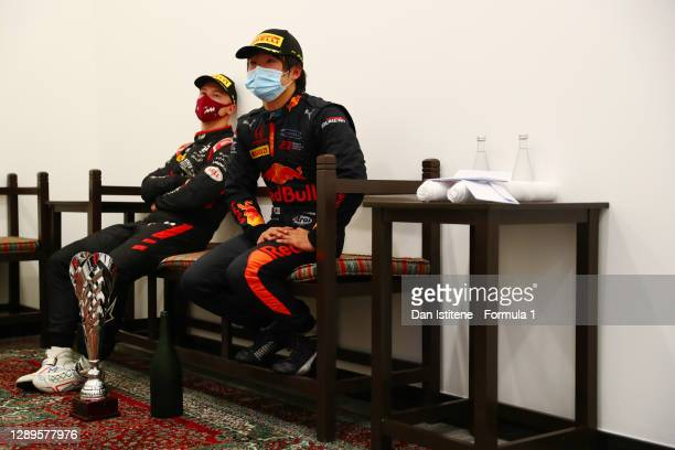 Race winner Yuki Tsunoda of Japan and Carlin and third placed Nikita Mazepin of Russia and Hitech Grand Prix wait for the podium ceremony during the...