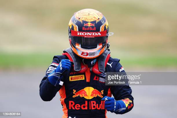 Race winner Yuki Tsunoda of Japan and Carlin celebrates in parc ferme during the sprint race of the Formula 2 Championship at Silverstone on August...