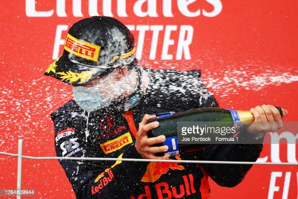 Race winner Yuki Tsunoda of Japan and Carlin celebrates on the podium during the sprint race of the Formula 2 Championship at Silverstone on August...