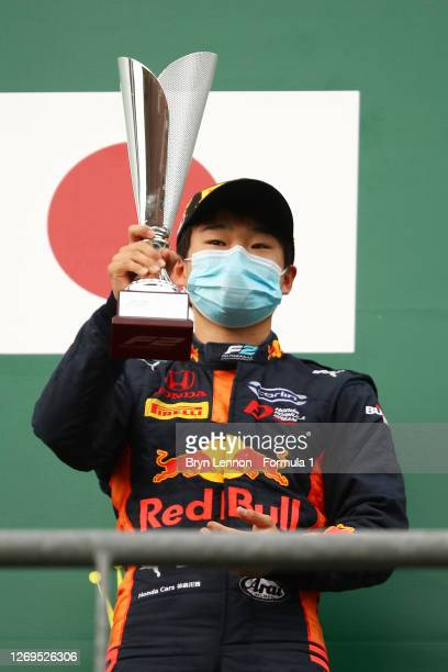 Race winner Yuki Tsunoda of Japan and Carlin celebrates on the podium after the feature race of the Formula 2 Championship at Circuit de...