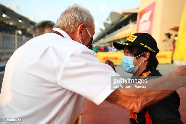 Race winner Yuki Tsunoda of Japan and Carlin is congratulated by Red Bull Racing Team Consultant Dr Helmut Marko in parc ferin parc fermeduring the...