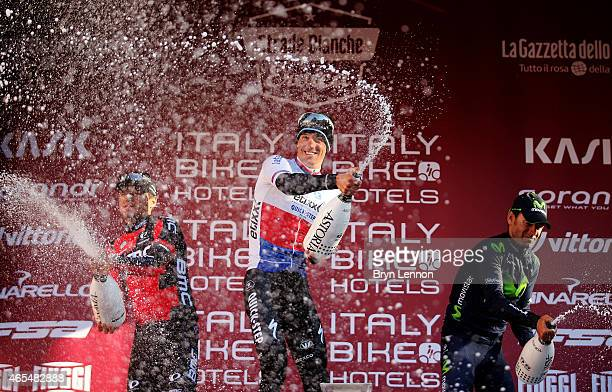 Race winner Zdenek Stybar of the Czech Republic and Etixx Quick Step celebrates with second placed Greg Van Avermaet of Belgium and BMC Racing Team...