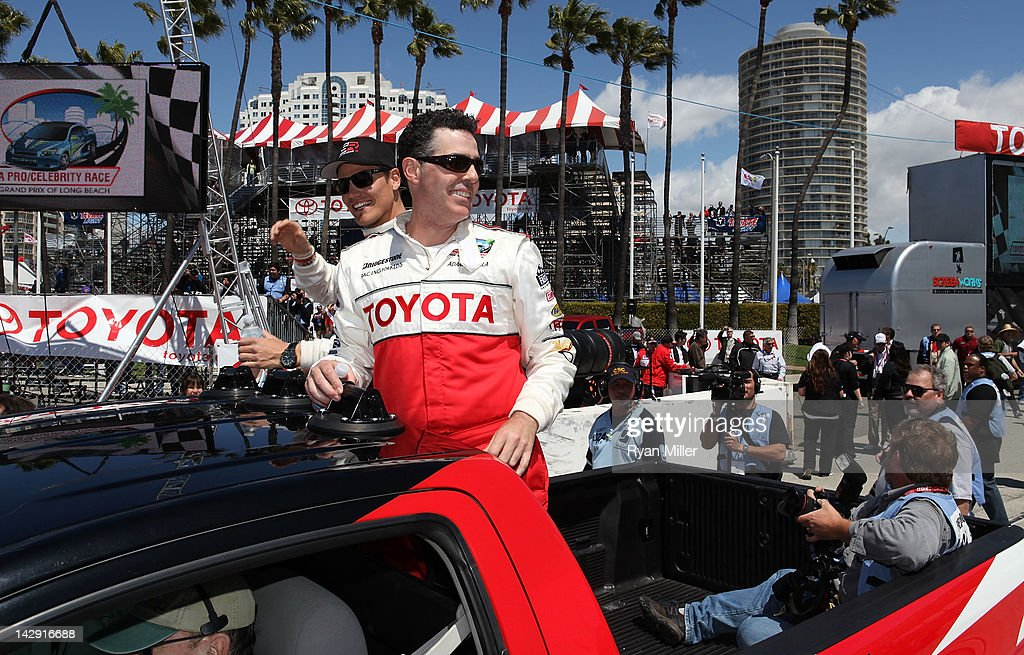 Race winners actor Adam Corolla (R) and drift driver Frederic Aasbo (L) take a victory lap in the back of a race truck during the 36th Annual Toyota Pro/Celebrity Race held at the Toyota Grand Prix of Long Beach on April 14, 2012 in Long Beach, California.
