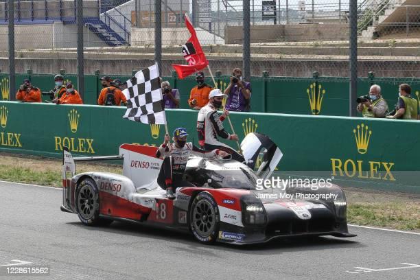 Race winners Brendon Hartley of New Zealand and Sebastien Buemi of Switzerland, with Kazuki Nakajima of Japan driving the Toyota Gazoo Racing Toyota...