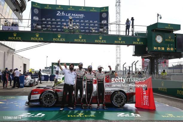 Race winners Brendon Hartley of New Zealand, Kazuki Nakajima of Japan and Sebastien Buemi of Switzerland, celebrate victory for the Toyota Gazoo...