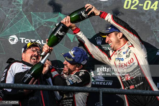 Race winners Fernando Alonso of Spain and Toyota Gazoo Racing and Sebastien Buemi of Switzerland and Toyota Gazoo Racing celebrate with Rob Leupen of...