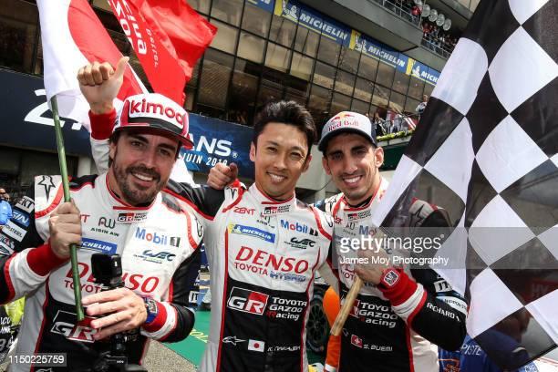 Race winners Fernando Alonso of Spain and Toyota Gazoo Racing, Kazuki Nakajima of Japan and Toyota Gazoo Racing and Sebastien Buemi of Switzerland...