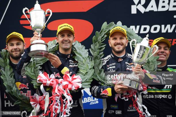 Race winners Jamie Whincup driver of the Red Bull Holden Racing Team Holden Commodore ZB and Paul Dumbrell driver of the Red Bull Holden Racing Team...