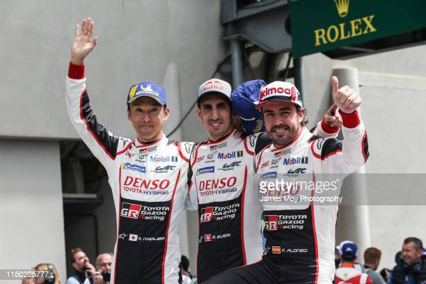 Race winners Kazuki Nakajima of Japan and Toyota Gazoo Racing, Sebastien Buemi of Switzerland and Toyota Gazoo Racing and Fernando Alonso of Spain...