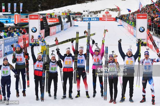 Race winners Norway's Marte Olsbu Roeiseland Norway's Tiril Eckhoff Norway's Tarjei Boe and Norway's Johannes Thingnes Boe celebrate after winning...