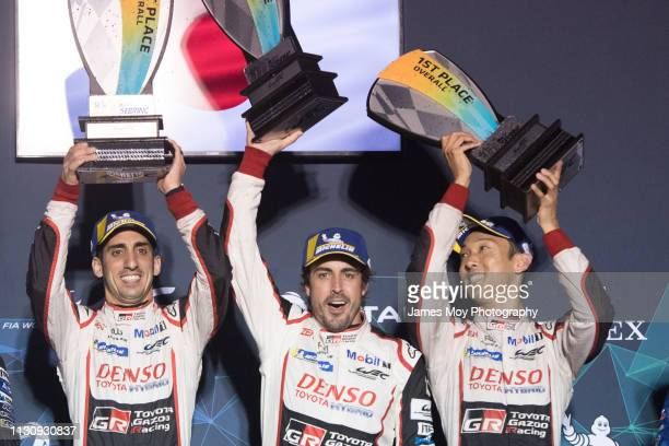 Race winners Sebastien Buemi of Switzerland and Toyota Gazoo Racing Fernando Alonso of Spain and Toyota Gazoo Racing and Kazuki Nakajima of Japan and...