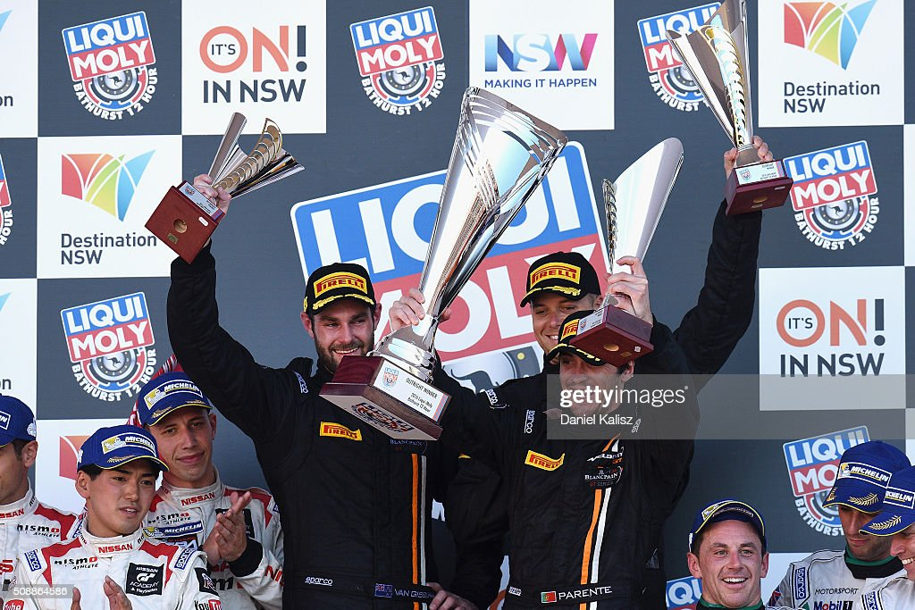 Race winners Shane van Gisbergen, Jonathon Webb and Alvaro Parente drivers of the #59 Tekno Autosport McLaren 650S celebrate on the podium after the Bathurst 12 Hour Race at Mount Panorama on February 7, 2016 in Bathurst, Australia.