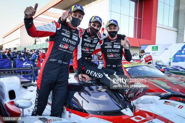 Race winners, the Toyota Gazoo Racing GR010 Hybrid of Brendon Hartley, Sebastien Buemi, and Kazuki Nakajima, celebrate in parc ferme at Autodromo do...