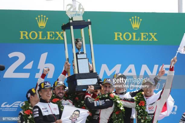 Race winners the Toyota Gazoo Racing TS050 Hybrid of Fernando Alonso of Spain Sebastien Buemi of Switzerland and Kazuki Nakajima of Japan celebrate...
