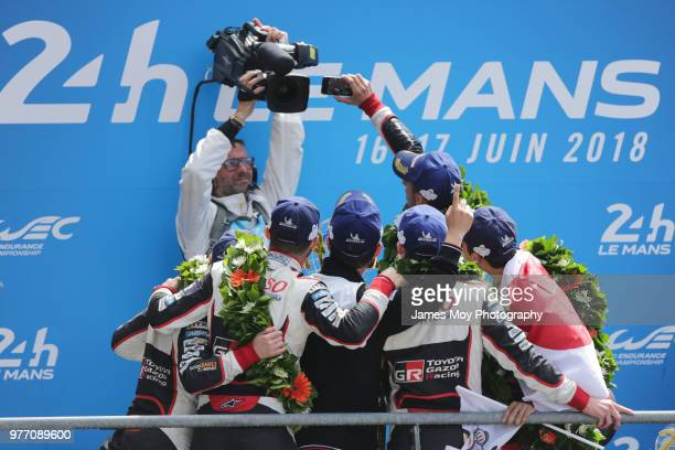 Race winners the Toyota Gazoo Racing TS050 Hybrid of Fernando Alonso of Spain Sebastien Buemi of Switzerland and Kazuki Nakajima of Japan celebrate...