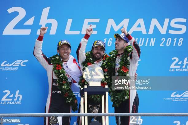 Race winners the Toyota Gazoo Racing TS050 Hybrid of Kazuki Nakajima of Japan Fernando Alonso of Spain and Sebastien Buemi of Switzerland celebrate...