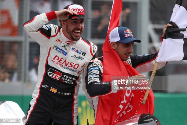 Race winners Toyota Gazoo Racing Fernando Alonso of Spain and Sebastien Buemi of Switzerland celebrate at the finish of the Le Mans 24 Hour race on...