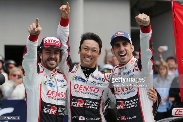 Race winners Toyota Gazoo Racing - Fernando Alonso of Spain, Kazuki Nakajima of Japan and Sebastien Buemi of Switzerland, celebrate in parc ferme at...