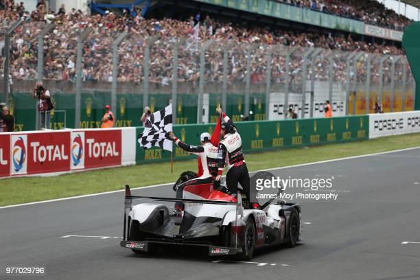 Race winners Toyota Gazoo Racing Fernando Alonso of Spain Kazuki Nakajima of Japan and Sebastien Buemi of Switzerland celebrate at the finish of the...