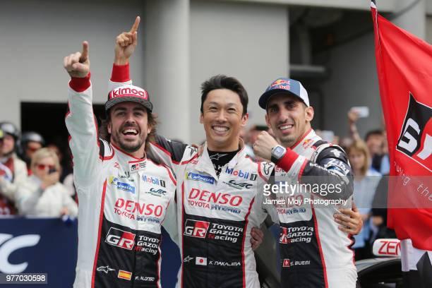 Race winners Toyota Gazoo Racing Fernando Alonso of Spain Kazuki Nakajima of Japan and Sebastien Buemi of Switzerland celebrate in parc ferme at the...