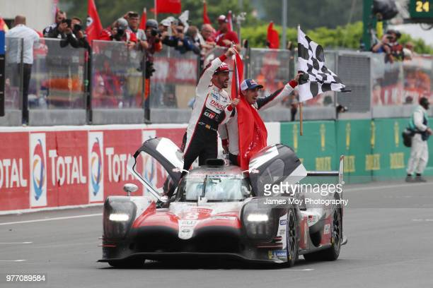 Race winners Toyota Gazoo Racing Fernando Alonso of Spain Kazuki Nakajima of Japan and Sebastien Buemi of Switzerland celebrate at the finish of the...
