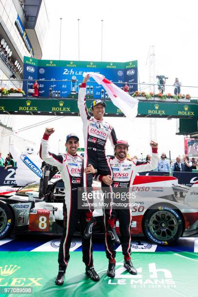 Race winners Toyota Gazoo Racing Fernando Alonso of Spain Kazuki Nakajima of Japan and Sebastien Buemi of Switzerland celebrate in parc ferme at the...