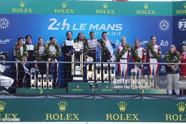 Race winners Toyota Gazoo Racing of Sebastien Buemi Kazuki Nakajima and Fernando Alonso celebrate on the podium with second placed Toyota Gazoo...