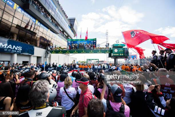 Race winners Toyota Gazoo Racing of Sebastien Buemi Kazuki Nakajima and Fernando Alonso celebrate on the podium with second placed Toyota Gazoo...