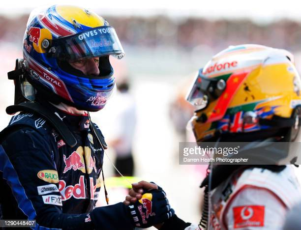 Race winning Australian Red Bull Racing Formula One racing driver Mark Webber shaking hands with McLaren driver and second place finisher Lewis...