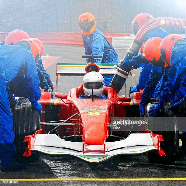racecar driver at the pit stop - will power race car driver stock pictures, royalty-free photos & images