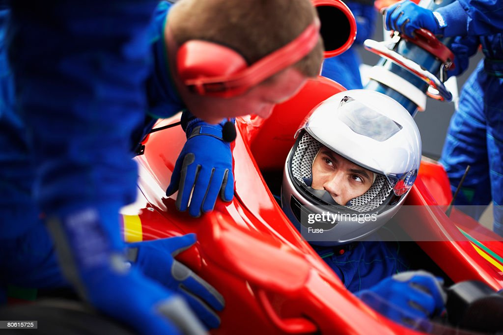 Racecar Driver at the Pit Stop : Stock Photo