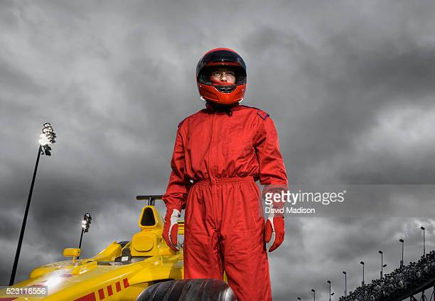 racecar driver by formula one racecar - race car driver stock pictures, royalty-free photos & images