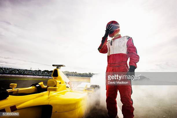 racecar driver by racecar with mechanical breakdown - race car driver stock pictures, royalty-free photos & images